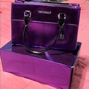 Younique brand new in box shiny purple purse